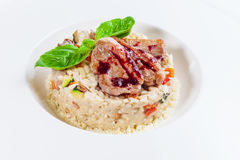 Risotto with meat of a duck Stock Photo