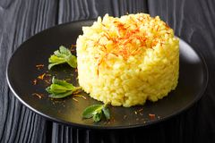 Risotto milanese, an italian recipe typical of Milan closeup. Ho. Risotto milanese, an italian recipe typical of Milan closeup on a plate. Horizontal stock image