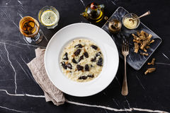 Risotto with morels and Dried morels Stock Photo