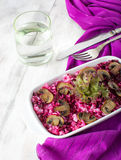 Risotto with mushrooms and beetroot. On a light background Stock Images