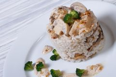 Risotto with mushrooms, broccoli and sauce Stock Photo
