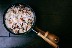 Risotto with mushrooms in cooking pan. Healthy vegetarian meal Stock Photography