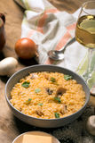 Risotto with mushrooms, fresh herbs and parmesan cheese. Wooden background Stock Photo