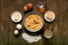 Risotto with mushrooms, fresh herbs and parmesan cheese. Wooden background, top view Royalty Free Stock Image