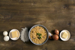 Risotto with mushrooms, fresh herbs and parmesan cheese. Wooden background, top view with copy space Stock Image