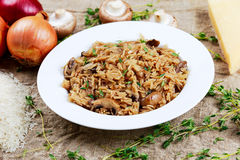 Risotto mushrooms with parmesan cheese, fresh herbs, rice, onion. Stock Images