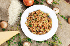 Risotto mushrooms with parmesan cheese, fresh herbs, rice, onion. Rice Risotto mushrooms with parmesan cheese, fresh herbs, rice, onion. background Royalty Free Stock Photography