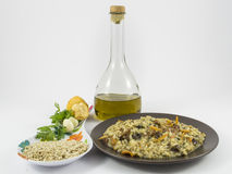 Risotto with mushrooms. A plate of risotto with mushrooms and its ingredients on white background Stock Photo