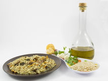 Risotto with mushrooms. A plate of risotto with mushrooms and its ingredients on white background Royalty Free Stock Image