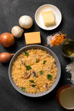 Risotto with mushrooms spices and parmesan cheese. Risotto with mushrooms, fresh herbs and parmesan cheese. black chalkboard, top view Royalty Free Stock Photography