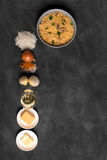 Risotto with mushrooms spices and parmesan cheese. Risotto with mushrooms, fresh herbs and parmesan cheese. black chalkboard, top view vertical orientation Royalty Free Stock Image