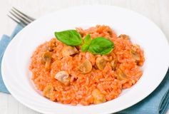 Risotto with mushrooms and tomatoes Royalty Free Stock Photo