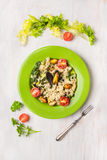 Risotto with mussels and green lettuce in a plate on white wooden Royalty Free Stock Photos