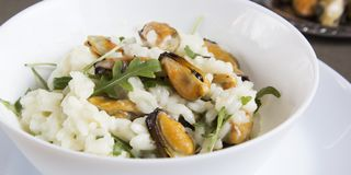 Risotto with mussels. Italian traditional food. Risotto with mussels. Italian traditional food Stock Photography