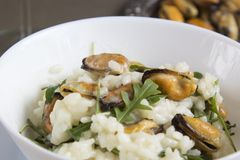 Risotto with mussels. Italian traditional food. Risotto with mussels. Italian traditional food Stock Image