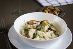 Risotto with mussels. Italian traditional food. Risotto with mussels. Italian traditional food Royalty Free Stock Image