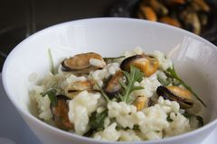 Risotto with mussels. Italian traditional food. Risotto with mussels. Italian traditional food Royalty Free Stock Photography