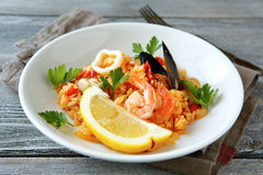 Risotto with mussels meat, rice and lemon Royalty Free Stock Image