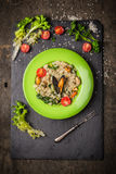 Risotto with mussels, tomatoes and green lettuce Stock Image