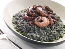 Risotto Nero with Fried Octopus and Pesto Dressing Stock Photography