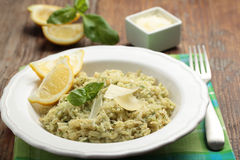 Risotto with Parmesan on a rustic table Stock Photo