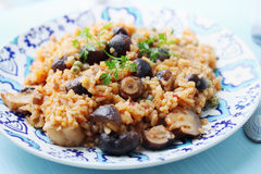 Risotto with porcini mushrooms. And green peas Royalty Free Stock Photo