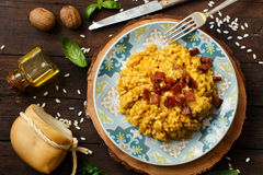 Risotto with a pumpkin and bacon. Close up Stock Photos