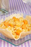 Risotto with pumpkin in a cheese basket Royalty Free Stock Photo