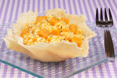 Risotto with pumpkin in a cheese basket Stock Photography