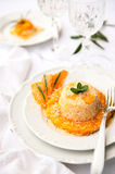 Risotto with pumpkin cream in white plate Stock Image