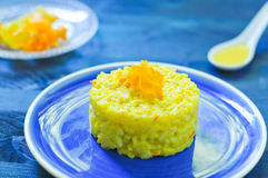 Risotto with pumpkin flowers with saffron Stock Photo