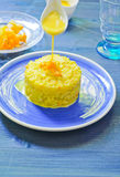 Risotto with pumpkin flowers with saffron Royalty Free Stock Image