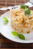 Risotto with pumpkin on a white dish Stock Image