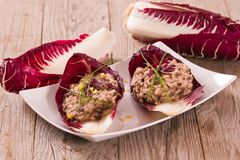 Risotto with red radicchio. Risotto with red radicchio on white dish stock photography