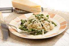 Risotto rice with asparagus and parmesan Royalty Free Stock Images