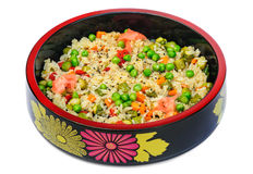 Risotto with rice, green peas, carrot, bell pepper, pickled cucumbers Royalty Free Stock Photo