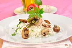 risotto rice with mushroom and salad Stock Image