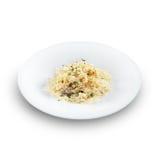 Risotto - riso cucinato con brodo e spruzzato con formaggio Fotografie Stock Libere da Diritti