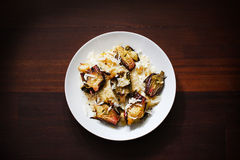 Risotto with roasted baby artichokes and parmesan. Risotto with buffalo mozzarella, roasted baby artichokes and parmesan Royalty Free Stock Images