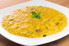 Risotto with saffron and mushrooms Royalty Free Stock Photos