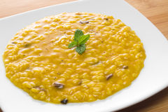 Risotto with saffron and mushrooms Stock Image