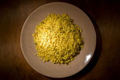 Risotto with Saffron on wooden table Royalty Free Stock Images