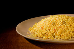 Risotto with Saffron on wooden table Stock Photos