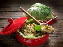Risotto with savoy cabbage. In red casserole Stock Photo