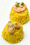 Risotto with  scallops and shrimp Stock Photos