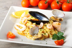 Risotto with seafood. On complex background Stock Images