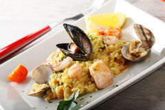 Risotto with seafood. On complex background Royalty Free Stock Photography