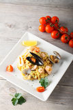 Risotto with seafood. On complex background Stock Photo