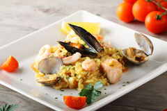 Risotto with seafood. On complex background Stock Image
