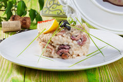 Risotto with seafood, octopus, shrimp, mussels, sea cocktail, romaine in still life Provence menu restaurant Stock Photos